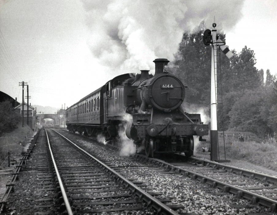 Locomotive 6144 with passenger train leaving Wheatley Station