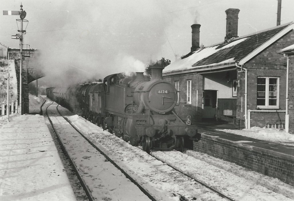 Locomotive 6124 with goods train at snowy Wheatley Station