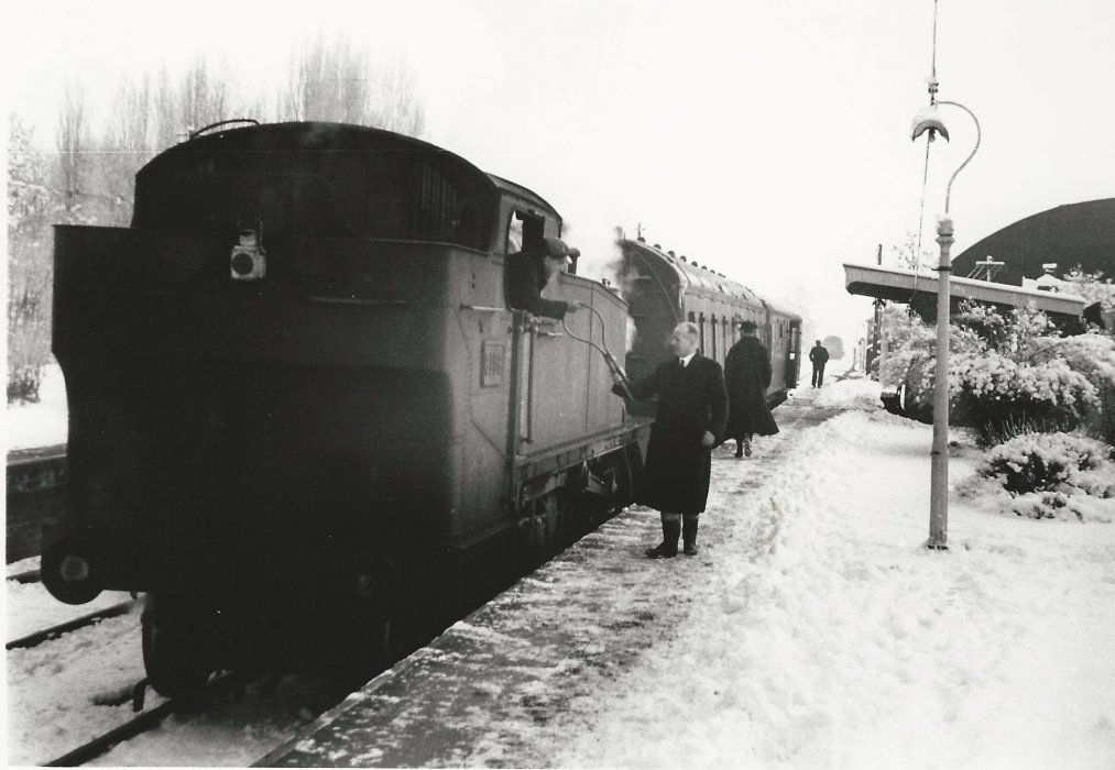 The passenger train driver receives the token before proceeding onto the single track