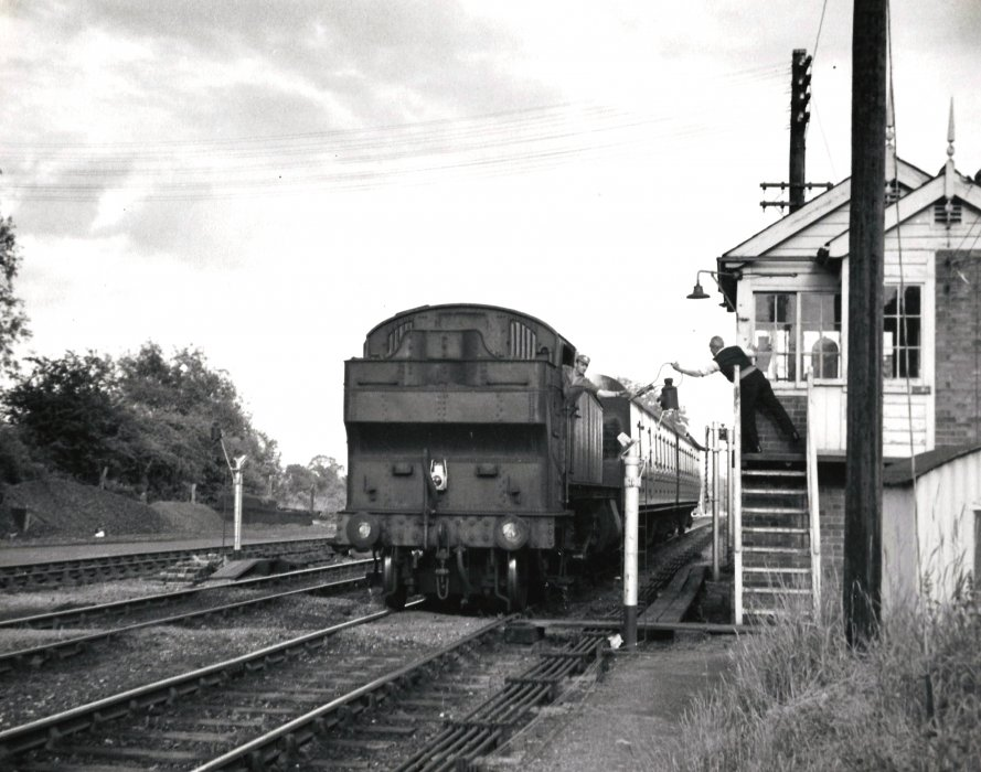 The safety of a single line track was ensured by the use of a token which was exchanged here between the driver and the signalman