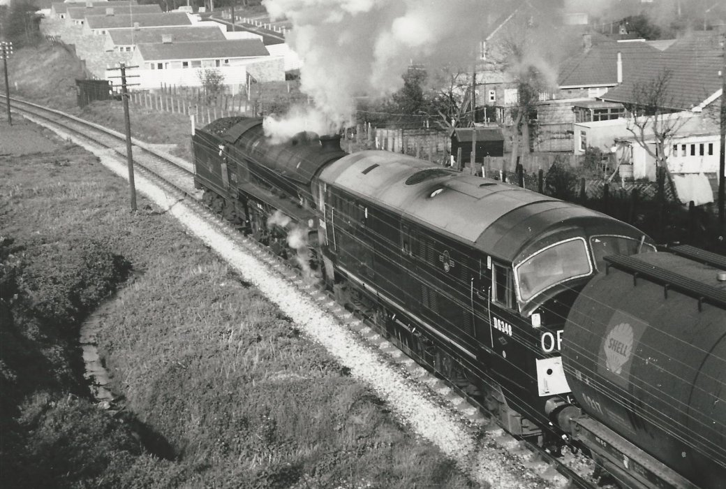 'Double-header' steam and diesel D6348 pulling goods train
