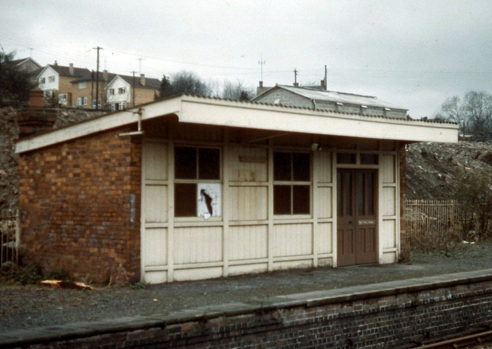The small station building on the platform on the south side with Ladder Hill houses in the background