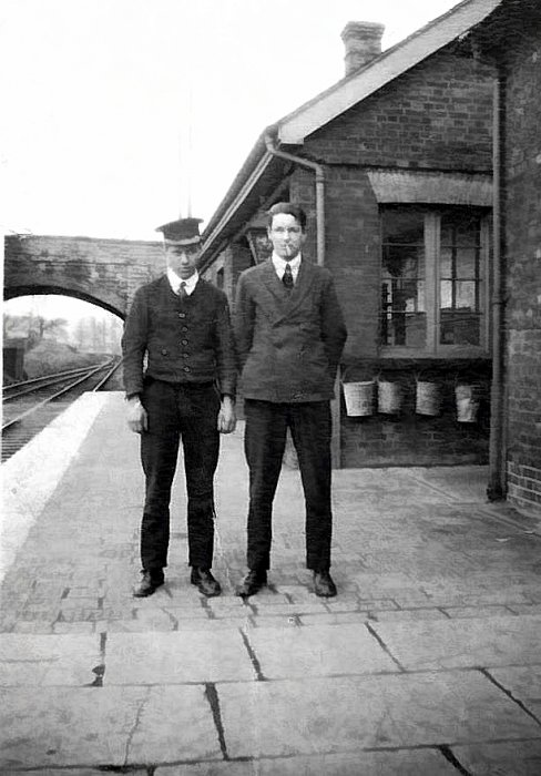 Mr Munt (Porter) and Mr R. W. Cox Stationmaster.