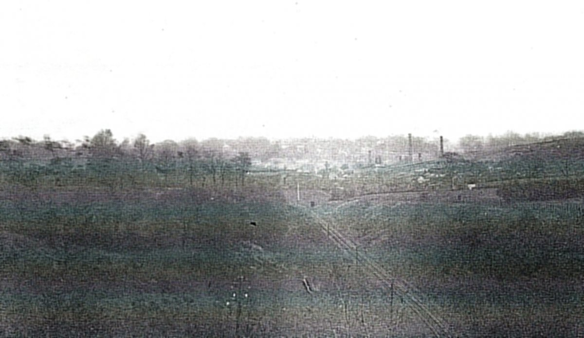 c. 1930. The chimneys of the brickworks are to the right of the railway line and Littleworth bridge.