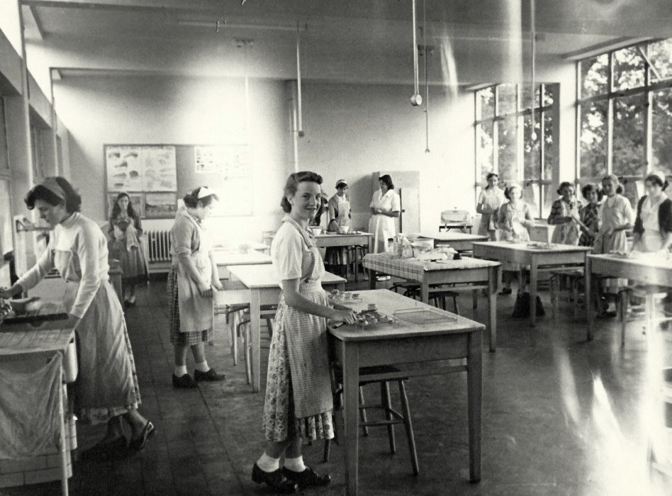 'Domestic Science' 1951-52. Olive Sherwood and Mrs Badcock, teacher in back ground