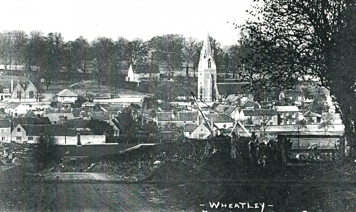 Postcard c. 1927. The crane was used for lifting the timber in the yard.