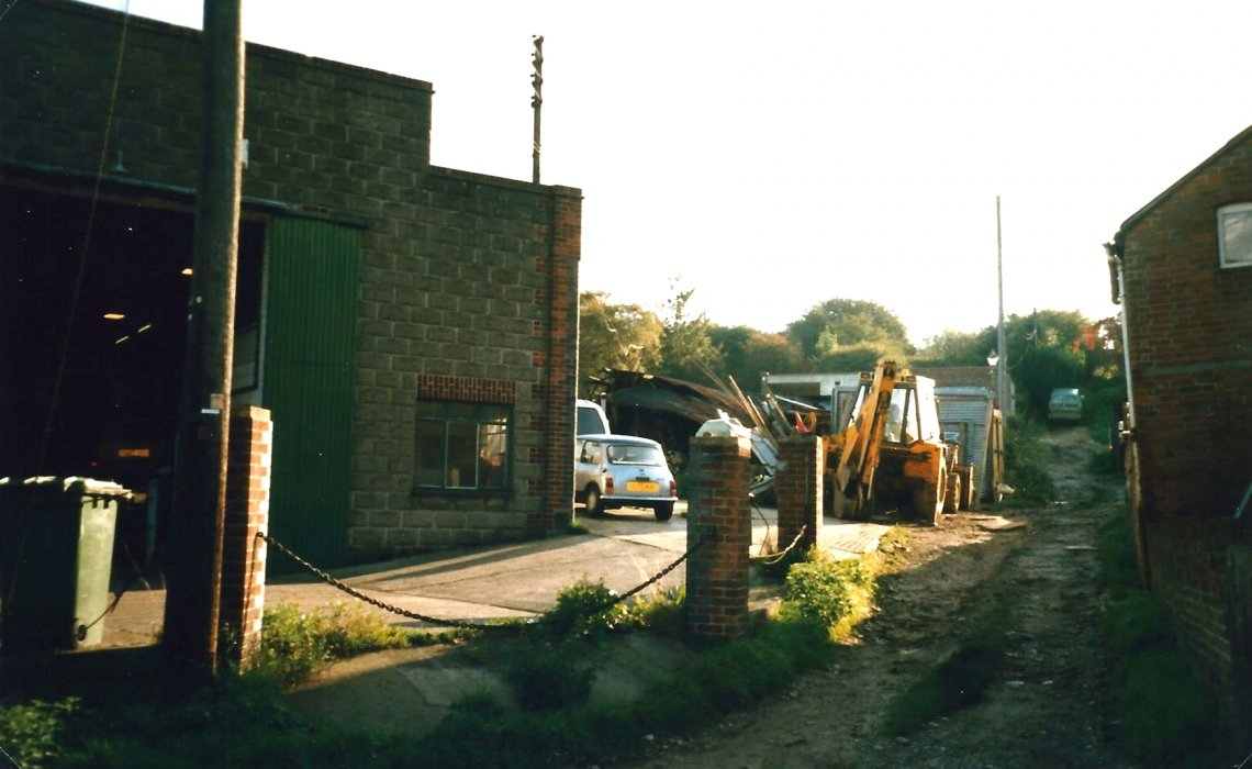Photo of the track leading towards the windmill past Powells Engineering works in 1988