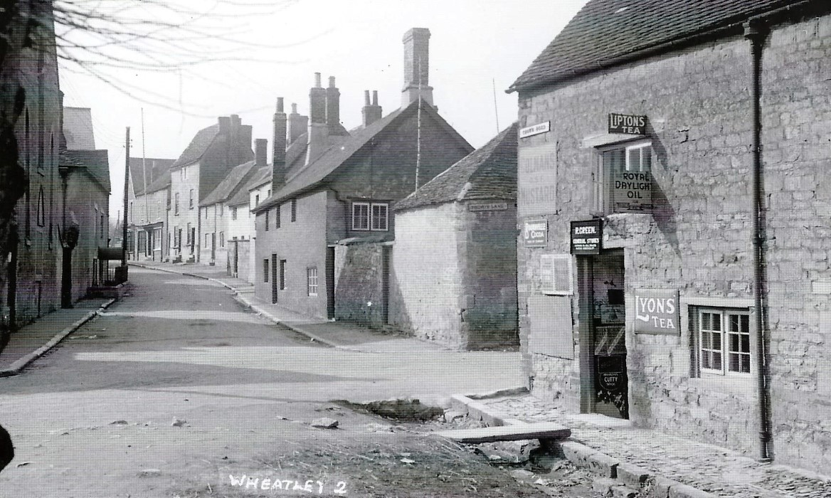 Photo of the High St, and the former Chequers Inn which became a shop, on the corner of Crown Square and Friday Lane