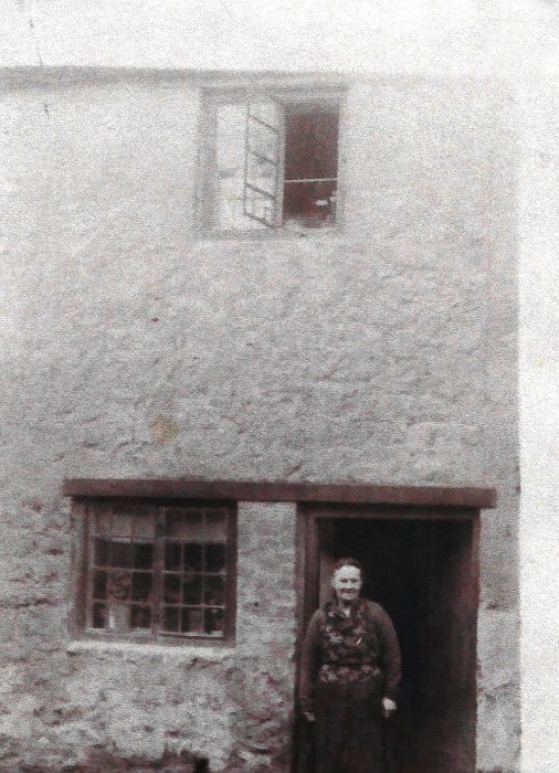 1950s. Mrs Illiot outside her Lowse Hill cottage.