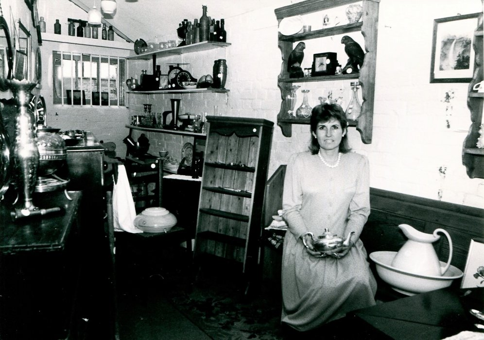 1988. Kathy Hawley in the antiques shop at 62 High street as shown in the Centenary booklet
