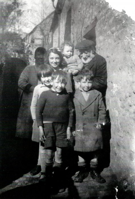 Sally Eldred, Norman, Noah Eldred, Crick Family in 1940 outside Tudor Cottage