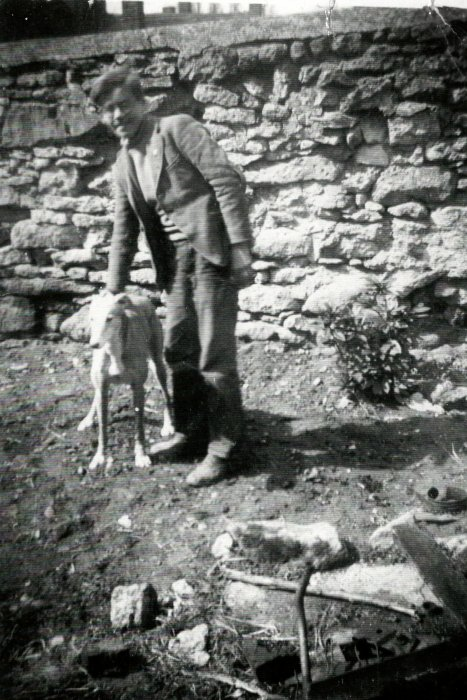 1950s. Norman Hanks with Lambourn Fawn outside Tudor Cottage
