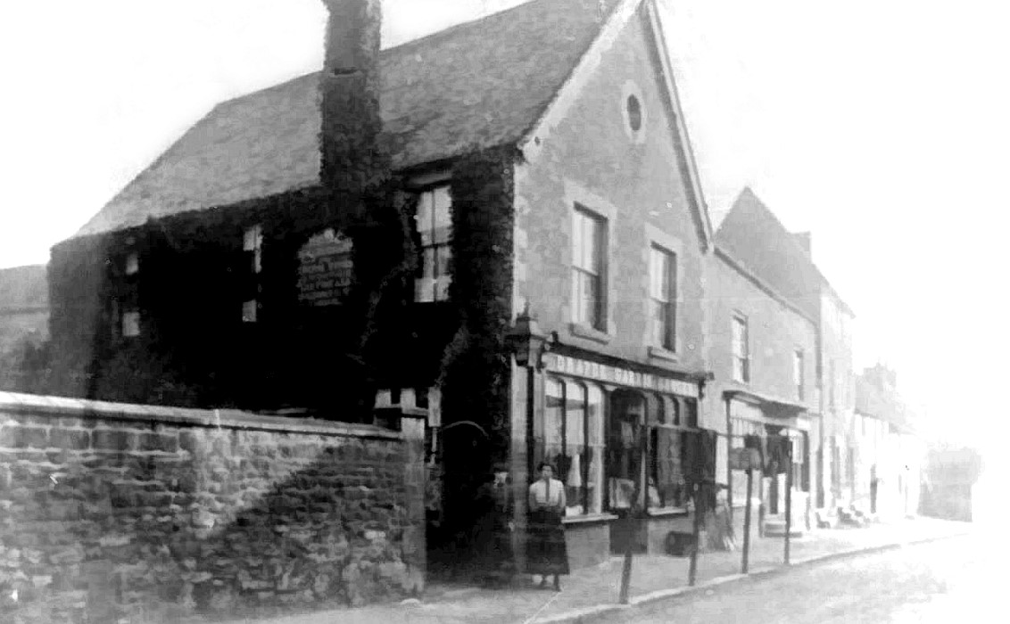 Early photo showing the wall, later demolished to create space for Barclays Bank