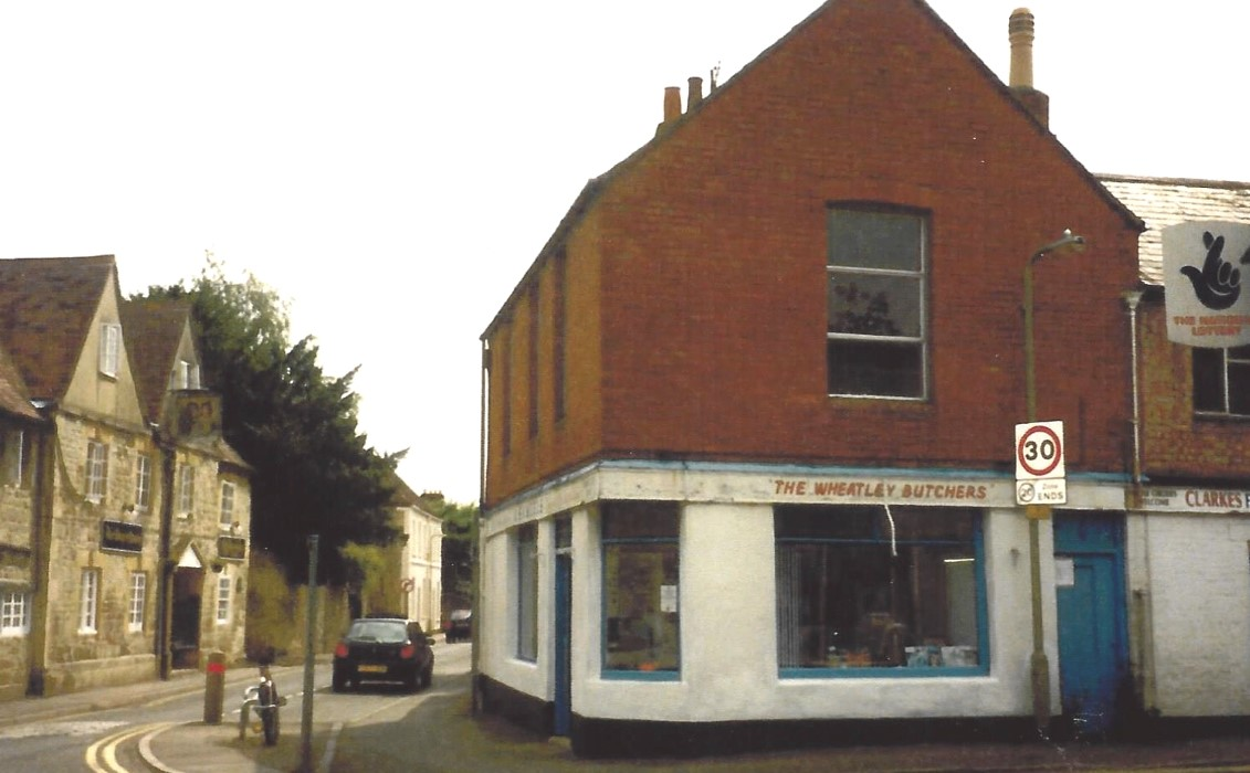 Probably taken before 2002 showing the south-east corner of Station Road with High Street when this was a Samuels butcher shop.