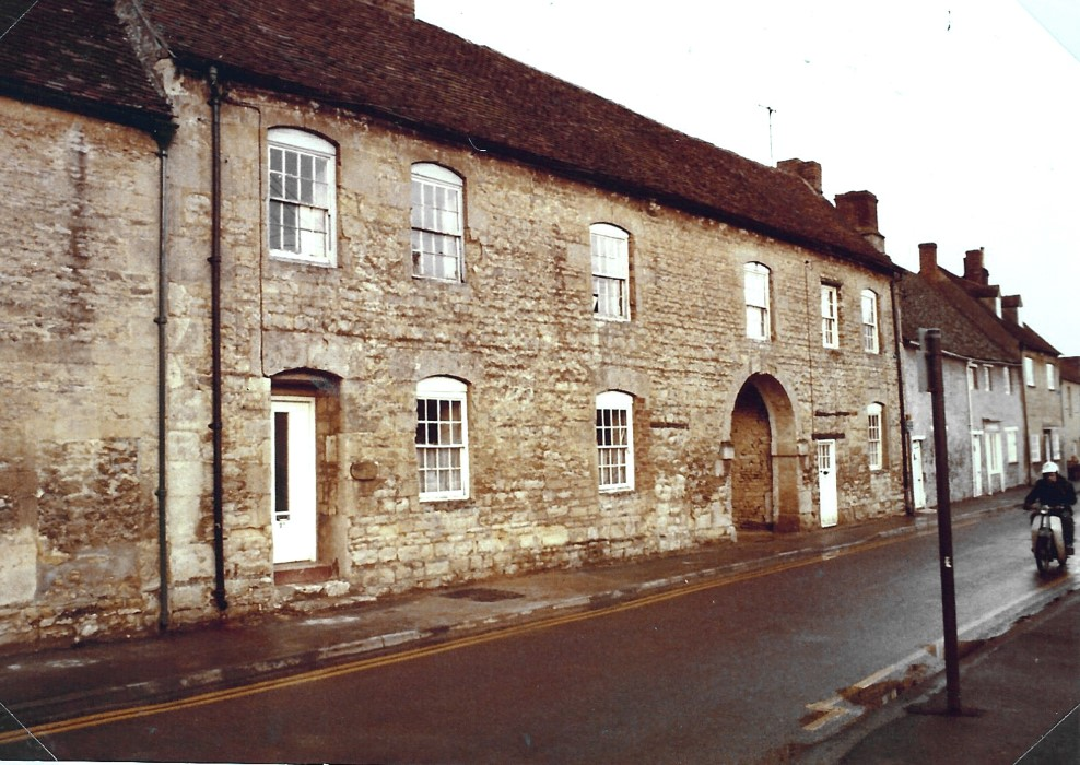 Photo of The George whilst still three separate homes. One was known as The Old Bakehouse