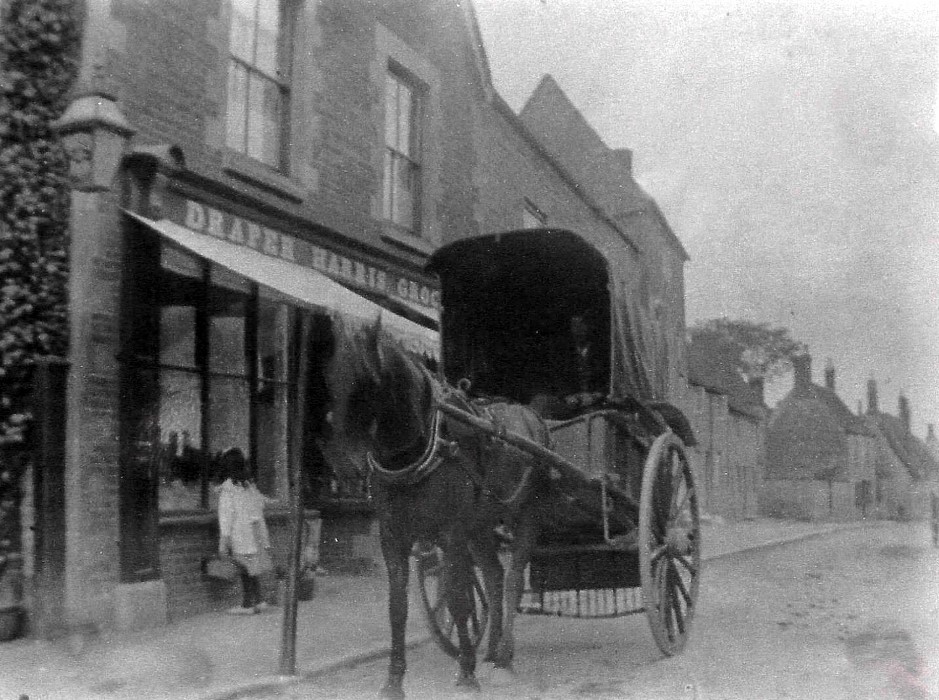 Huxter's cart outside Harris's shop