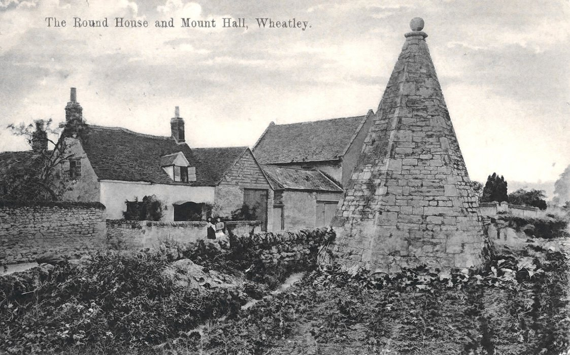 The Round House.. In the background is the picturesque white-washed Cromwell Cottage, now demolished, but was said to have been originally built for a servant of Cromwell's, from which it got its name.