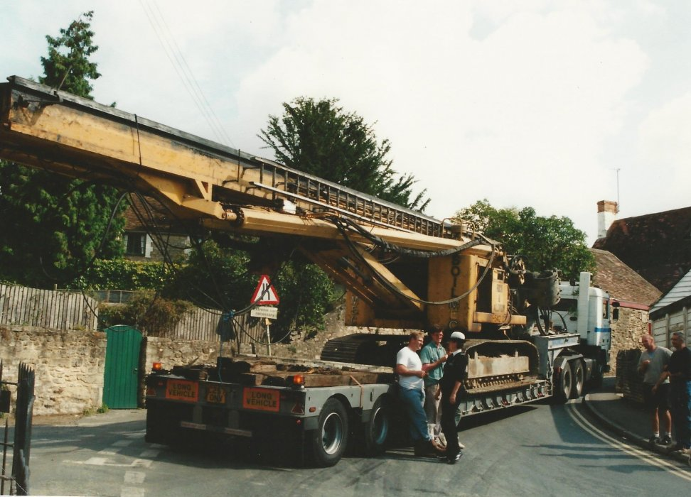 Low loader carrying a huge crane is stuck