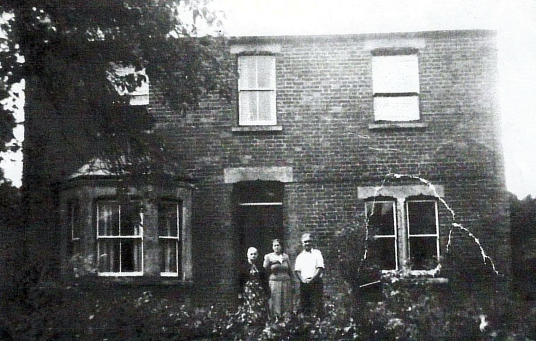 Horace Crabtree and his wife with Selina Barrett (nee Cripps) outside their house