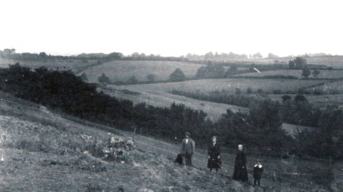 Crabtree Cottage was at No 111 Old Road, where Freshfield is today (2018). The view from the back of the cottage shows the open land across to the windmill on the skyline to the left. The people are Selina Barrett in the long dress, her daughter Ellen and her two sons.