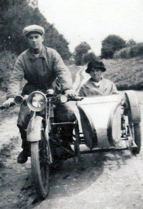 Selina Barrett being driven by her son, Bert, along Old Road in the early 1930s.