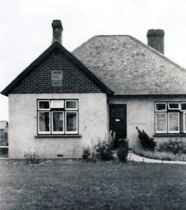 91 Old Road. Bert Barrett bought this plot of land c. 1939 and built this bungalow. In the gable end was a stone Acanthus leaf carved by his brother, Tom, who was a stone mason and worked on the colleges in Oxford.