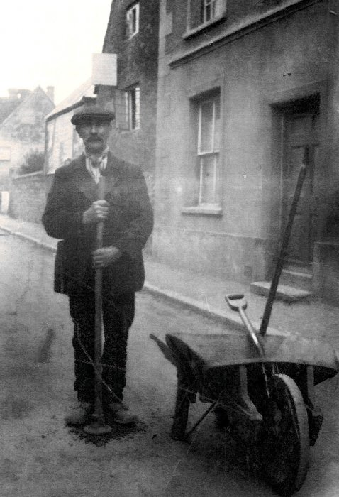 Charles Shorter filling potholes in the High Street about 1920 – nothing changes!
