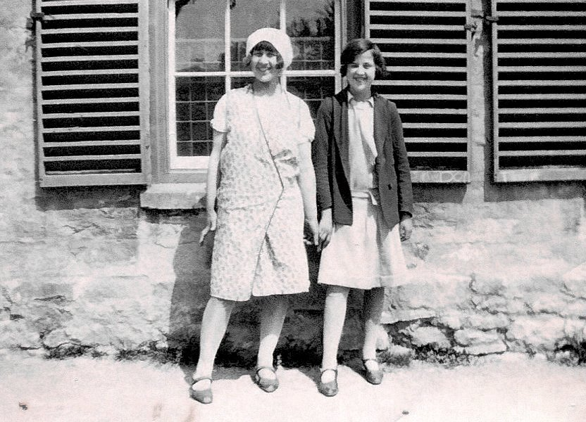 Phyllis West with sister Agnes outside The Parsonage about 1930