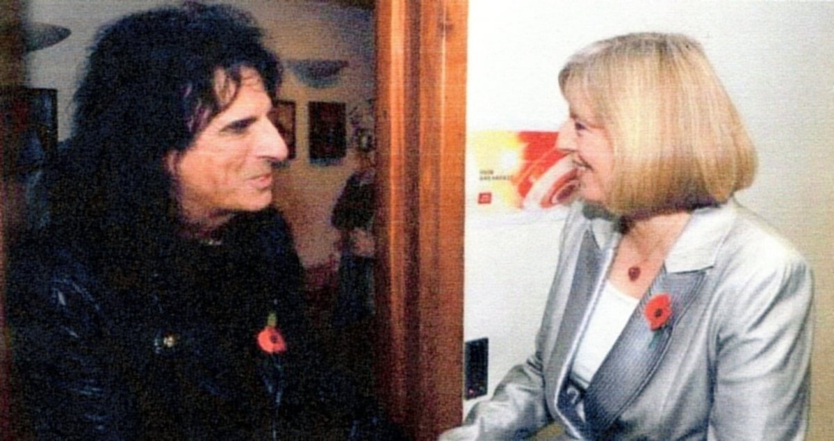 Theresa May with some rock star (I think)