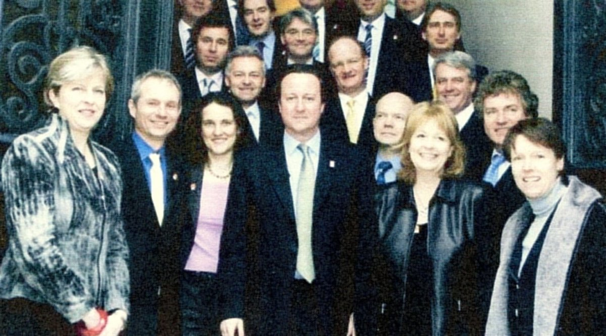 Theresa May with David Cameron and other party members