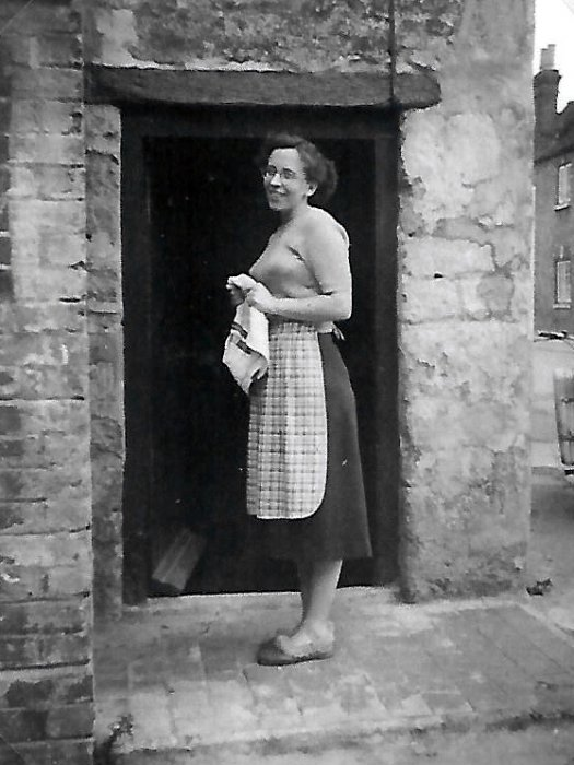 Joy French at the side door of her cottage in the 1950s.