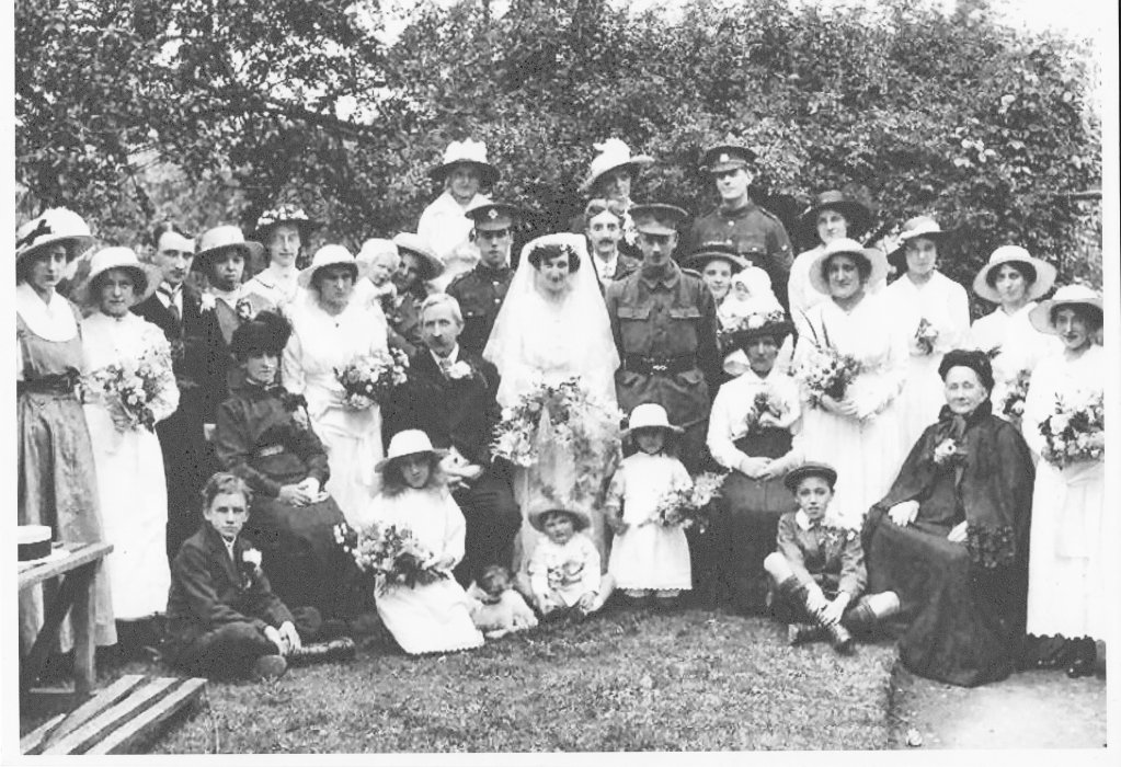 The families and guests at Ernest Barrett and Ethel Croucher's wedding. Ernest's brother William (standing behind the bride) was Best Man. (Courtesy Mrs Mavis Ramsden)