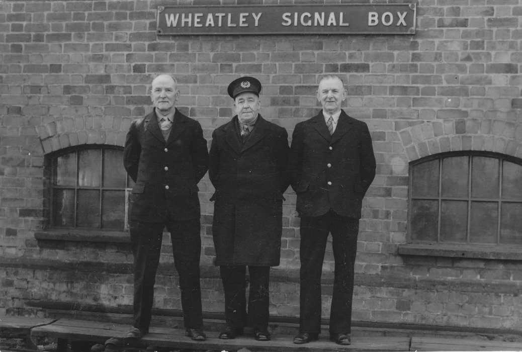 Llewellyn Jackson (left) at the GWR yard in 1958, with District Inspector Rumble and signalman Bill Cox (Wheatley Village Archive)